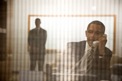 President Obama takes a conference call coordinating the response to Hurricane Sandy.